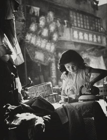 A girl earns money ironing (1958)